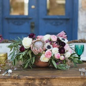 Plum and Blush Protea Centerpiece | Charla Storey Photography and Grit + Gold | Regal Hacienda Wedding Shoot in Rich Jewel Tones