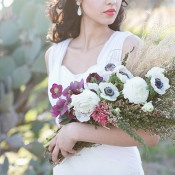 Clutch of Purple and White Flowers | Charla Storey Photography and Grit + Gold | Regal Hacienda Wedding Shoot in Rich Jewel Tones