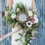 Protea, Anemone, and Jasmine Vine Bouquet | Charla Storey Photography and Grit + Gold | Regal Hacienda Wedding Shoot in Rich Jewel Tones