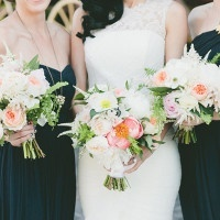 Bridesmaids in Black with Coral Bouquets | onelove photography | Stylish Rockstar Wedding at a Southern California Vineyard in Ivory, Coral, and Gold
