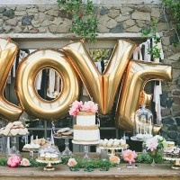 Gold LOVE Balloons for a Modern Dessert Display | onelove photography | Stylish Rockstar Wedding at a Southern California Vineyard in Ivory, Coral, and Gold