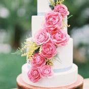 Bright Pink Sugar Roses Cascading down a Wedding Cake | Audrey Norman Fine Art Wedding Photography