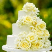 Tiered Cake Adorned with White Flowers | MIke Larson Photography | Chic Lake Tahoe Wedding on the Beach