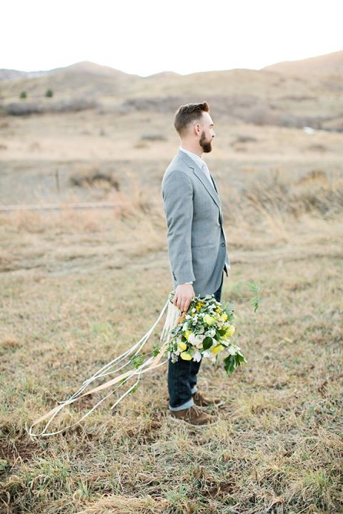 Groom in Gray with a Yellow Bouquet   Callie Hobbs Photography   Bohemian Desert Wedding Shoot in Colorado