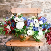 Lush Anemone and Delphinium Centerpiece | Samantha Kirk Photography | Blue, Burgundy, and Bronze Spring Wedding