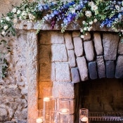 Floral Mantel Decor and Floating Candles | Samantha Kirk Photography | Blue, Burgundy, and Bronze Spring Wedding