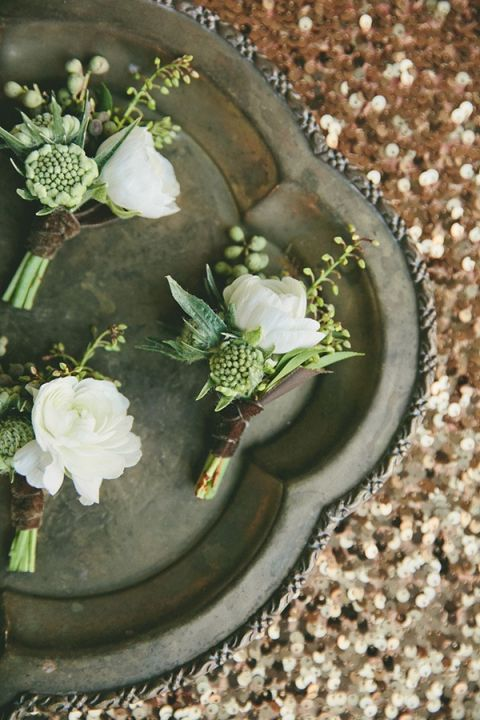 Green and White Boutonnieres on Bronze Sequins