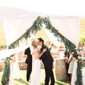 Wedding Ceremony with Greenery Garlands and White Drapery   Danielle Poff Photography   Natural Elegance at a Southern California Vineyard