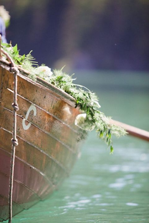 Vintage Rowboat with a Floral Garland | Sandra Aberg Photography | Destination Engagement on a Midsummer Lake