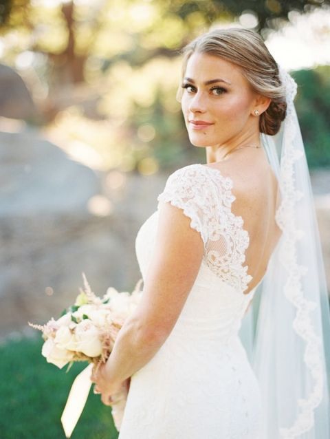 Lace Cap Sleeve Wedding Dress with an Elegant Bridal Updo | Danielle Poff Photography | Effortlessly Chic Sparkling Neutral Wedding