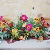 Vibrant Fuchsia and Yellow Centerpiece | Jessica Burke Photography | Colorful California Mission Wedding Style