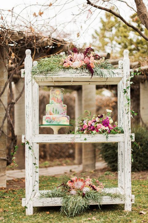 Lush floral display with a watercolor wedding cake claire marika and