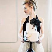 Dramatic, Black, Purple, and Gold Wedding Cake | Jeff Brummett Visuals | City Chic Wedding - https://heyweddinglady.com/city-chic-wedding-black-white-purple/