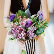Shades of Purple Bouquet with Striped Ribbon | Jeff Brummett Visuals | City Chic Wedding - https://heyweddinglady.com/city-chic-wedding-black-white-purple/
