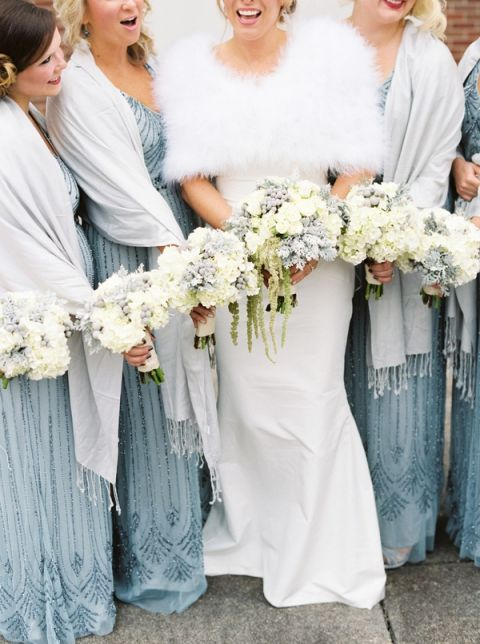 Bride and Bridesmaids in Cozy Wraps | JoPhoto Photography | https://heyweddinglady.com/cozy-glam-winter-wedding-ideas/