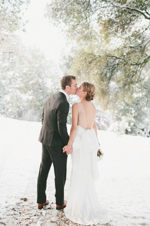 Classically Glam Winter Bride in the Snow | onelove photography | https://heyweddinglady.com/cozy-glam-winter-wedding-ideas/