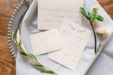 Chic Gray and Blue Calligraphy Invitation | Gavin Farrington Photography | Event Design and Styling by Glow Event Design - https://heyweddinglady.com/winter-chic-intimate-holiday-wedding-cozy-neutrals-2