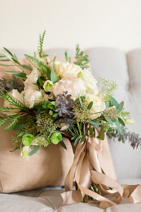 Elegant Green and White Winter Bouquet | Gavin Farrington Photography | Event Design and Styling by Glow Event Design - https://heyweddinglady.com/winter-chic-intimate-holiday-wedding-cozy-neutrals-2