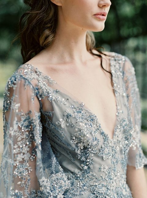 Sparkling Dusty Blue Wedding Dress with Flutter Sleeves | Laura Gordon Photography | https://heyweddinglady.com/modern-war-and-peace-wedding-inspiration-blue-silver/