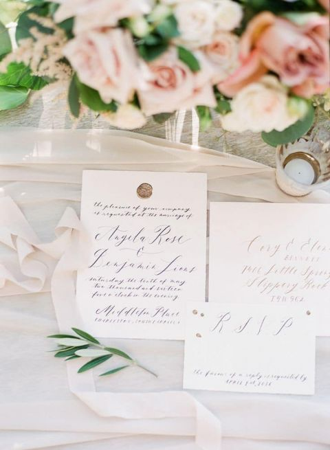 Elegant Calligraphy Invitation with a Custom Wax Seal | Vasia Photography | https://heyweddinglady.com/modern-war-and-peace-wedding-inspiration-blue-silver/