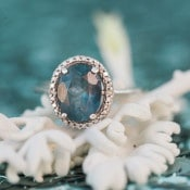 Blue Topaz Engagement Ring | B. Jones Photography | https://heyweddinglady.com/glam-mermaid-wedding-moonlit-coast/