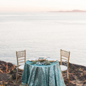 Seaside Sweetheart Table with Aqua Sequins and Copper Lanterns | B. Jones Photography | https://heyweddinglady.com/glam-mermaid-wedding-moonlit-coast/