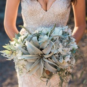 Sea Green Succulent Bouquet with a Glittering Gold Wedding Dress | B. Jones Photography | https://heyweddinglady.com/glam-mermaid-wedding-moonlit-coast/
