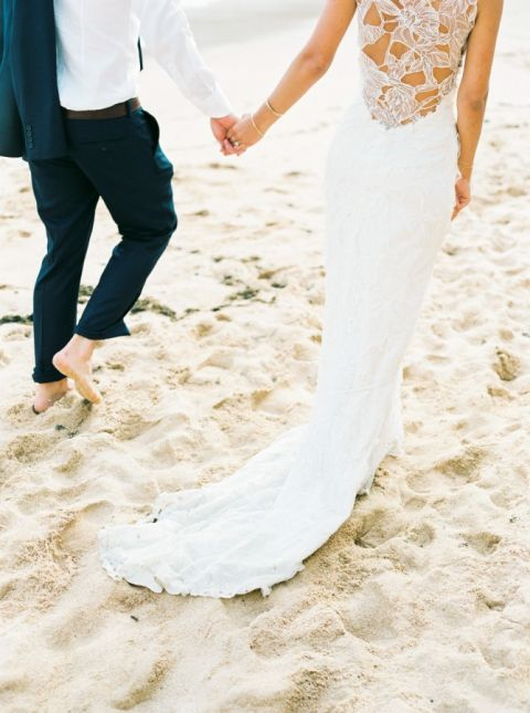 Gorgeous Beach Bride with a Floral Lace Wedding Dress | Love is my Favorite Color Photography| https://heyweddinglady.com/tropical-beach-glam-bahamas-wedding-sparkling-gold-pink/