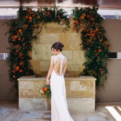 Wedding Arch in Dramatic Orange and a Backless Wedding Dress | Allen Tsai Photography | https://heyweddinglady.com/edgy-modern-wedding-dramatic-blood-orange-black/
