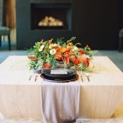 Intimate Fireside Sweetheart Table for a Striking Modern Wedding | Allen Tsai Photography | http://heyweddinglady.com/edgy-modern-wedding-dramatic-blood-orange-black/