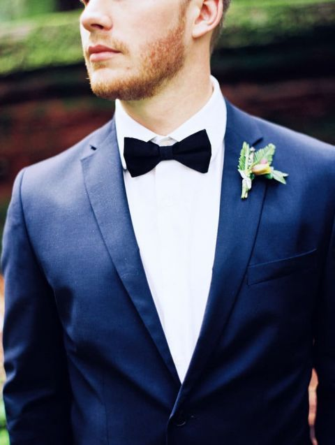 Groom in a Classic Navy Suit with a Black Bow Tie | Perry Vaile Photography | https://heyweddinglady.com/fine-art-adventure-loving-redwood-elopement/