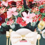 Gold, Black, and Berry Place Setting with a Lush Floral Runner | Marissa Lambert Photography | https://heyweddinglady.com/modern-southern-glamour-preppy-stripes/
