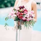 Red and Pink Bouquet with Trailing Jasmine and Striped Ribbons | Marissa Lambert Photography | http://heyweddinglady.com/modern-southern-glamour-preppy-stripes/