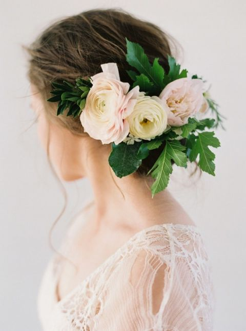 Romantic Bridal Updo with a Delicate Floral Headpiece