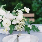 Lush White and Green Centerpiece with Sky Blue Linens | Heather Hawkins Photography | http://heyweddinglady.com/floral-romance-blush-peonies-spring-wedding/