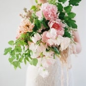Stunning Garden Inspired Bouquet with Blush Peonies | Heather Hawkins Photography | https://heyweddinglady.com/floral-romance-blush-peonies-spring-wedding/