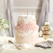 Blush Ruffled Cake with Gold Candles | SLF Weddings | https://heyweddinglady.com/intimate-love-story-engagement-blush-taupe-gold/