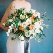 White and Orange Bouquet with Fresh Greenery | Rebecca Hollis Photography | https://heyweddinglady.com/lush-fine-art-wedding-florals-spring/