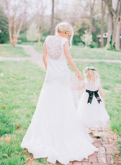 Classic Bride with the Sweetest Flower Girl | Jordan Brittley Photography | https://heyweddinglady.com/luminous-spring-garden-wedding-ilac-gray-blush/