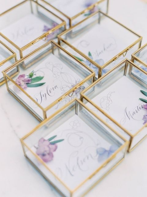 Gold and Crystal Escort Cards with Pressed Flowers | Sally Pinera Photography | https://heyweddinglady.com/spring-watercolor-wedding-inspiration-lavender-sage-green/