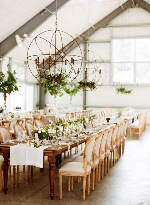 Elegant Barn Reception With Lighting Fixtures Adorned Greenery