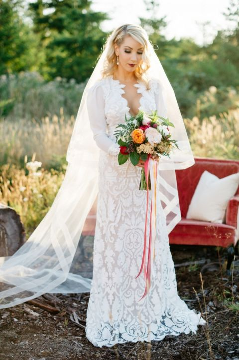 Modern Long Sleeve Lace Wedding Dress with a Colorful Bouquet