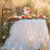 Sweetheart Table with a Colorful Floral Runner | Tonie Christine Photography | https://heyweddinglady.com/colorful-modern-elopement-magic-hour/