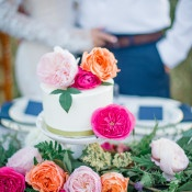 Pink, Fuchsia, and Orange Wedding Cake | Tonie Christine Photography | https://heyweddinglady.com/colorful-modern-elopement-magic-hour/