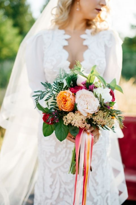 Pink and Orange Bouquet with a Modern Lace Wedding Dress