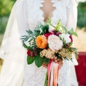 Pink and Orange Bouquet with a Modern Lace Wedding Dress | Tonie Christine Photography | https://heyweddinglady.com/colorful-modern-elopement-magic-hour/