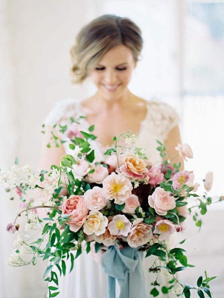 Peach and Blush Bouquet with a Bold Blue Ribbon