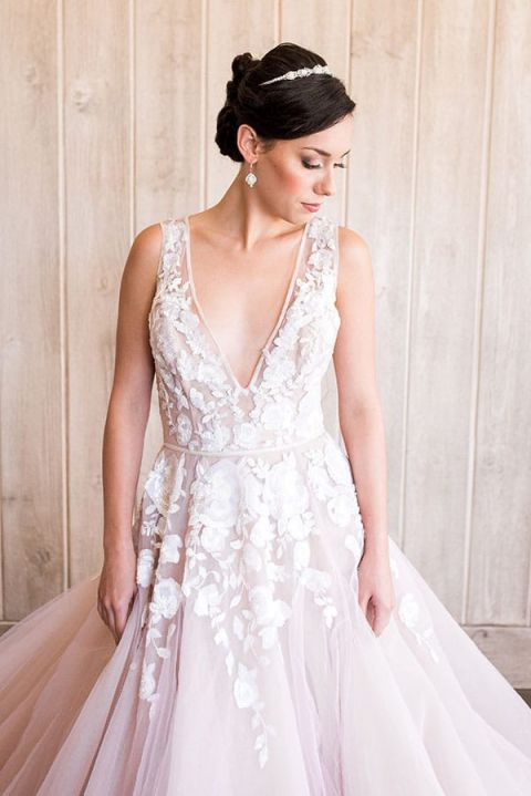 Styling a modern bridal tiara with a blush wedding dress hey romantic blush wedding dress with a plunging neckline and beaded flowers junglespirit Choice Image