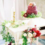 Plum and Garnet Wedding Cake Display with Floral Garlands