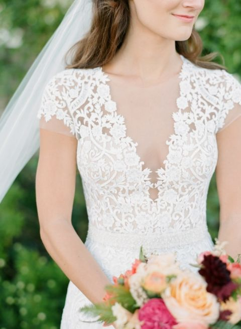 Short Sleeve Lace Wedding Dress with a Plunging Neckline